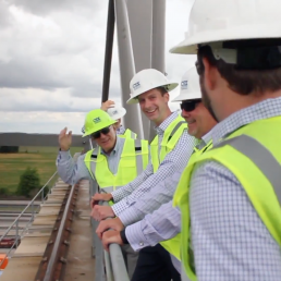 Group of industrial men on bridge