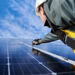 man working on solar panel